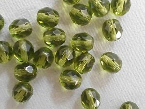 12 Czech fire polished olive green glass beads 8mm. Nice transparent beads!