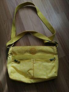 Yellow fabric shoulder bag with many pockets. KIPLING