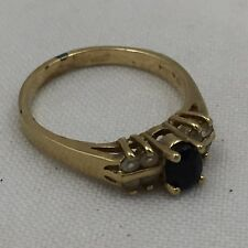 GOLD COLOR RING COSTUME JEWELRY WITH SOLID BLACK STONE & 8 WHITE STONES-SIZE 8.5