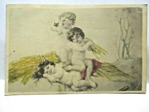 1918 POSTCARD 3 LITTLE CHERUBS WITH HAY, HOLDING TINY KITTEN, HAND COLORED