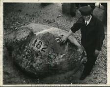 1937 Press Photo Gus Wurtzburger shows vandalism of Plymouth Rock, Massachusetts