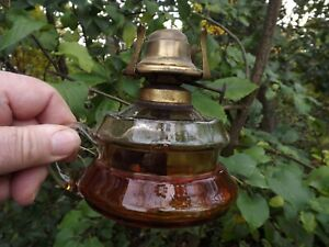 Vintage Glass Finger Lamp with brass fittings. Amber glass to base