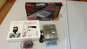 Original Super Nintendo Console with original box and 4 videogames