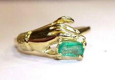 18K Yellow Gold Hand Holding a Colombian Emerald Ring Size 5.5