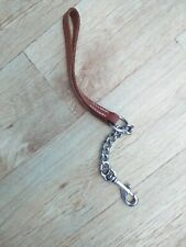 7 inch short dog chain with leather  strap.  Strong clip, used few times only