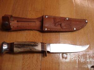 Jagdmesser mit Horngriff und Ledertasche