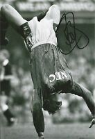 A 12 x 8 inch photo personally signed by Peter Beagrie when at Everton.
