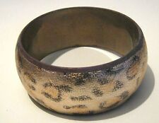 Great bangle style bracelet in a gold tone leopard skin style decoration