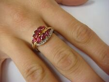 CLUSTER LEAF DESIGN RUBY AND DIAMONDS LADIES RING, 10K YELLOW GOLD, SIZE 8.