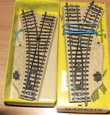 Modellbahnen der Spur H0 als Set aus Pappe-Dreileiter-Gleissystem