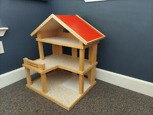 Plan Toys Wooden Dollhouse with furniture and 2 dolls