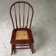 primitive and rare Windsor cane seat rocker with hand turned lathe spindles