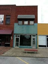 Two-story commercial building, roughly 3000 sq ft, very rough condition