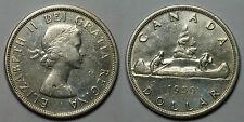 CANADA.  1 DOLAR 1959. RAYITAS. GOLPECITOS Y PUNZON EN ANVERSO.   MBC+