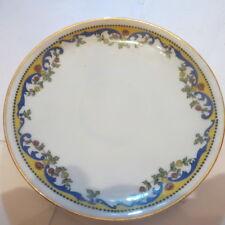 Petite assiette avec liseré or et fleurs « Suisse Langentaal »