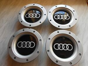 SET OF 4 AUD I WHEEL CENTRE CAPS FOR 9+12 SPOKE ALLOYS 147MM.56-58mm REAR FIT