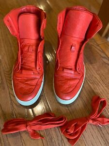 Red High Top Authentic Gucci Sneakers.
