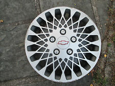 one 1989 1990 Chevy Celebrity Lumina APV hubcap wheel cover