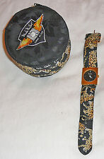 Nicole Miller TIME FLIES edition watch with fabric padded drum case, circa 1980s