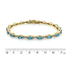 9ct Yellow Gold - Rhodium Plated Light Swiss Blue Topaz & CZ Bracelet.
