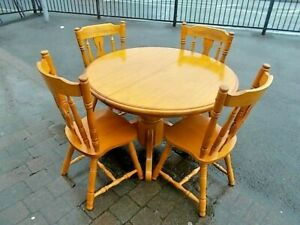 Round Teak Table and 4 Chairs   Buyer to collect