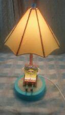 spongebob squarepants lounging on the beach lamp