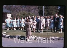 1960s Kodachrome photo slide Group of ladies singing  Man with camera
