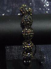 Lovely dark brown material bracelet with spiky beads adjustable