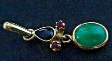 18 cts gold pendant with natural colombian emerald, 2 rubis 1 sapphire