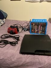 Sony PS3 Slim -160GB W/ 2 DualShock 3 Controllers And 5 Games