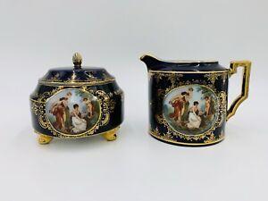 Hand Painted Royal Blue Gold Gilt Porcelain Creamer and Sugar Set. Greek Scene