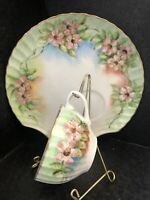 VINTAGE TEA CUP AND SHELL SHAPE SAUCER HAND PAINTED PINK FLOWERS ON GREEN SIGNED