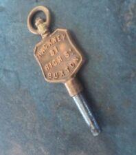 Advertising Pocket Watch Key  -  Hackney of 31 High St. ,  Buxton ,  Derbyshire