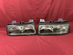 NOS OEM Chevrolet Corsica Headlamp Light 1987 - 1988 Pair