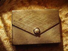 Poudrier Elisabeth Arden boite à poudre. à la forme d'une pochette
