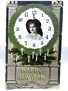 1912 POSTCARD HAPPY NEW YEAR, GIRL'S FACE ON CLOCK, WREATH AND CANDLES