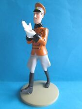 FIGURINE COLLECTION TINTIN/ LE ROI MUSKAR ENFILE SES GANTS