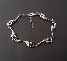Bracelet Handmade from Silver Tone Giraffe Charms Secured with a Lobster Clasp