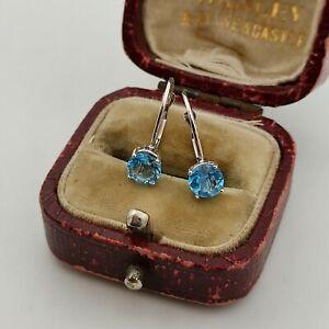 9ct White Gold Blue Topaz Lever Back Stud Earrings