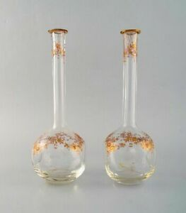 Two vases in mouth blown art glass with hand-painted flowers in gold.
