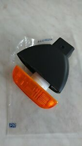 Nissan Cabstar F24, TL0, side indicator body and lens unit, new genuine parts.