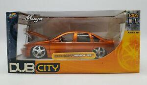 Jada Dub City 1996 Chevy Impala SS 1/24 Diecast Copper Orange Wheels by Maya DTS