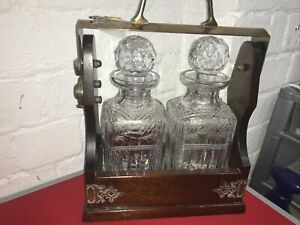Two Decanter Tantalus In Solid Oak Frame With Brass Fittings /key