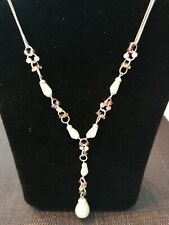 Silver tone necklace with drop pendant and matching bracelet