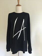 PRETTYLITTLETHING Black Oversized Long Sleeved T/Shirt with LA slogan, Size S