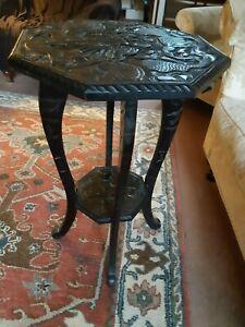 ANTIQUE DARK WOOD OCTAGONAL HEAVILY CARVED ORIENTAL PEDESTAL TABLE