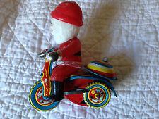 Vintage Suzuki Windup Santa on Tricycle Merry Balloon Made In Japan