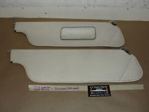OEM 73 Cadillac Coupe Deville SUN VISORS WITH MOUNTING HINGES - OFF WHITE