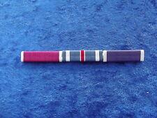 ^ Ordensspange WWII mit 3 Ribbons: Legion of Merit, Flying Cross, Purple Heart
