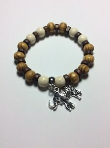 Stretch bracele lightt brown wood howlite beads elephant dangle charm 19cm